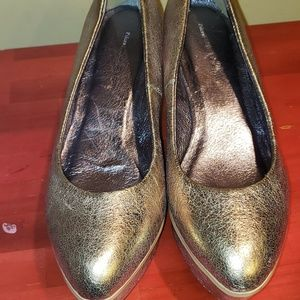 Shiny gold metallic wedges by Anthropologie
